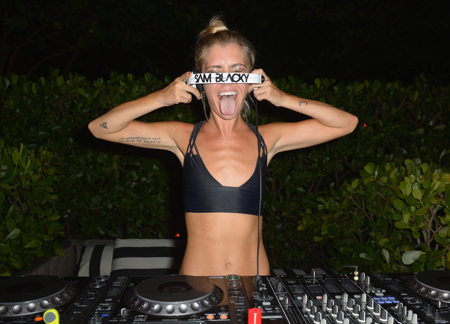 MIAMI BEACH, FL - JULY 15: DJ Sam Blacky spins at KAOHS 2017 Collection at SwimMiami - Backstage at W South Beach on July 15, 2016 in Miami Beach, Florida. (Photo by Gustavo Caballero/Getty Images for KAOHS)